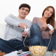 Young couple playing computer games - Stock Photo