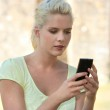 Woman looking mobile message — Stock Photo #9583962