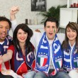 Group of friends supporting France and Italy — Stock Photo