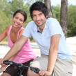 Couple on bicycle - Stock Photo
