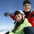 Stock Photo: Couple snowboarding