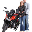 Stock Photo: Couple with motorbike
