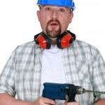 Man with beard holding power drill — Stock Photo