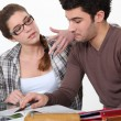 Male and female students revising together — Stock Photo