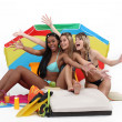 Three teenage women having fun at the beach. — Stock Photo