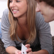 Stock Photo: Young couple playing cards