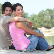 Couple sat by lake — Stock Photo #9584779