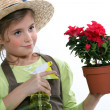 Stock Photo: Girl caring plant