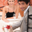 Man giving gift to woman — Stock Photo