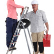 Electrician and apprentice on a ladder — Stock Photo