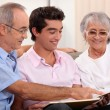 Grandparents and grandson watching photo album — Stock Photo