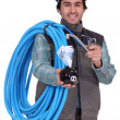Stock Photo: Plumber with piggy bank