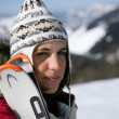 Portrait of young woman at ski resort — Stockfoto #9585820