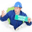 Decorator with a wet paint sign in French — Stock Photo
