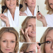 Woman in bathrobe putting make-up on — Stock Photo