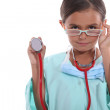 Child wearing grown up hospital scrubs, glasses and a stethoscope — Stock Photo #9587921