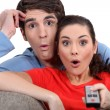 Shocked couple watching television — Stock Photo #9588387