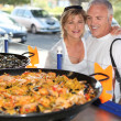 Foto de Stock  : Couple in front of paella