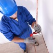Plumber with copper tube — Stock Photo