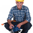Smiling man with a circular saw — Stock Photo #9589706