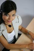 Woman wearing a headset — Stock Photo
