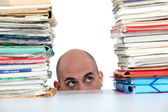 Man peering at files — Stock Photo