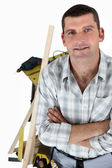 Carpenter with a workbench — Stock Photo