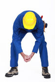 Worker bending over — Stock Photo