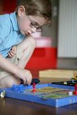 Little boy playing alone — Stock Photo