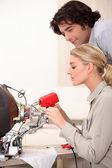 Woman repairing a television set — Stock Photo