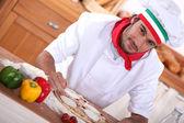 Italian chef making pizza — Stock Photo