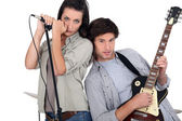 Couple rocking in a band — Stock Photo