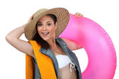 Woman with beach equipment — Stock Photo