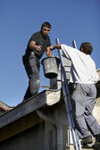 Workers on a roof — Stock Photo