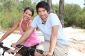 Couple on bicycle — Stock Photo