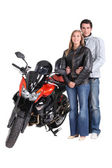 Couple with motorbike — Stock Photo