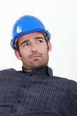 Attractive man in a hardhat — Stock Photo