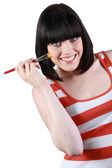 Una donna bruna con una matita make-up — Foto Stock
