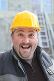 Excited chubby manual worker — Stock Photo