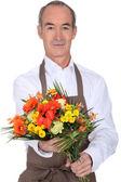 Senior florist holding a bouquet — Stock Photo