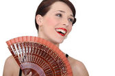Woman with oriental hand fan — Stock Photo