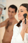Couple in the bathroom getting ready — Stock Photo