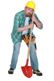 Craftsman looking tired with whovel isolated on white — Stock Photo