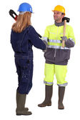Construction workers shaking hands — Stock Photo