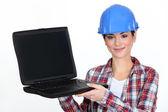 Female contractor holding laptop — Stock Photo