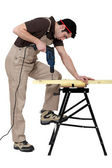 Carpenter drill through plank of wood — Stock Photo