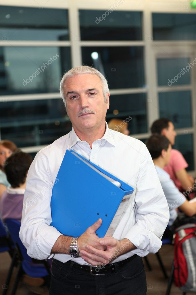 A teacher supervising an exam  Stock Photo #9582395