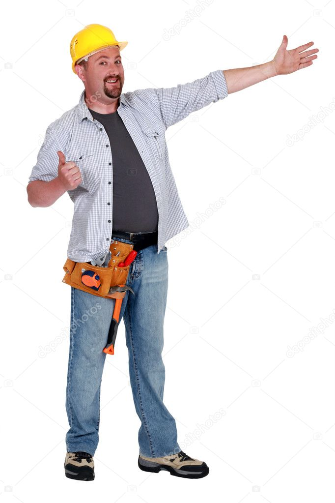 Carpenter giving thumbs-up  Stock Photo #9583512