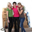 Royalty-Free Stock Photo: Three housemates moving
