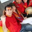 Four Spanish soccer fans waiting for the match to start — Stock Photo